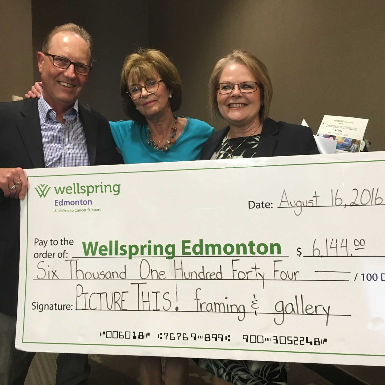 Picture This Presents Donation Cheque to Wellspring Edmonton